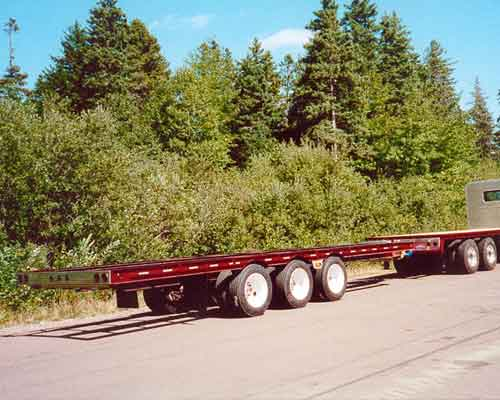 30 ton flatbed trailer with ABS brakes and truck deck with aluminum headache rack - Higgins Lumber.